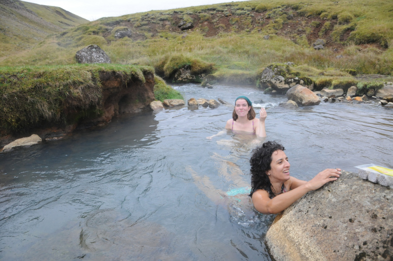 Girls swimming in a natural hot spring
